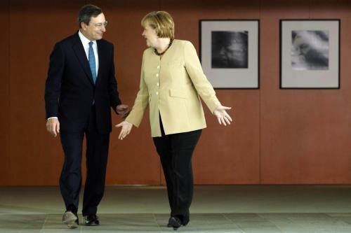 Mario Draghi con Angela Merkel
