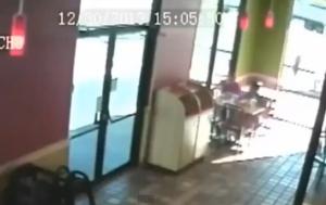 Florida, suv sfonda vetrina di un ristorante