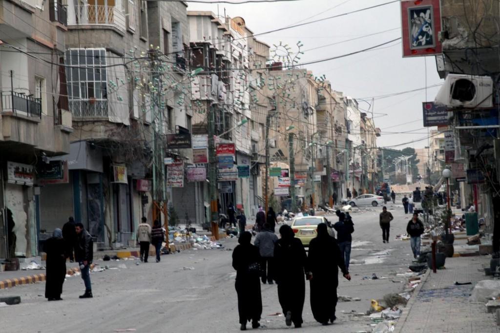 Siria, donne e bambini via da Homs