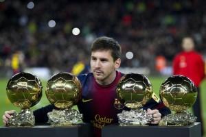 Messi, stella del Barcellona, con i suoi 4 Palloni d'Oro (Ansa)