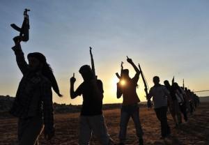 Guarda la versione ingrandita di Isis, Peshmerga, jihadisti sui barconi: