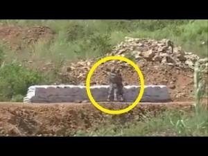 Cina, sbaglia il lancio della bomba a mano: il comandante lo trascina via