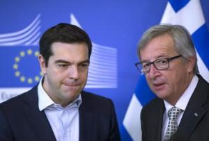 Grecia: critiche da Ocse, Troika e Juncker. Tsipras: Non mi fate paura. Borse giù