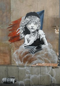 Guarda la versione ingrandita di A new artwork by British artist Banksy opposite the French Embassy, in London, Monday, Jan. 25, 2016. The artwork depicts the young girl from the musical Les Miserables with tears streaming from her eyes as a can of CS gas lies beneath her. The work is criticising the use of teargas in the refugee camp in Calais. (ANSA/AP Photo/Alastair Grant)