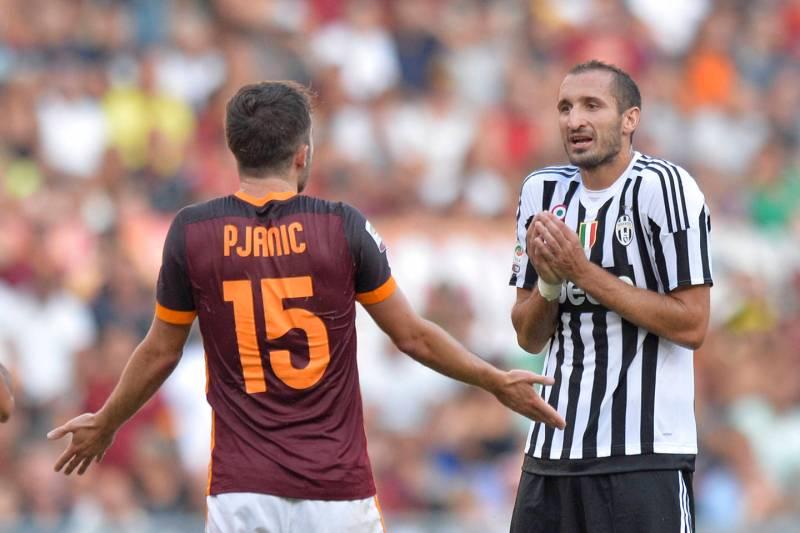 Juventus - Roma, Pjanic e Chiellini nella foto LaPresse