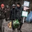 Profughi nel fango, combattono neve e gelo tra le baracche12