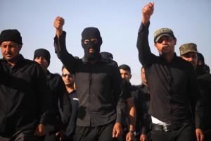 """Guarda la versione ingrandita di Isis, Libero: """"Anche l'Italia ha addestrato jihadisti"""""""