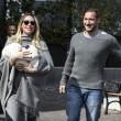 Ilary Blasi e Totti escono da clinica con Isabel 3