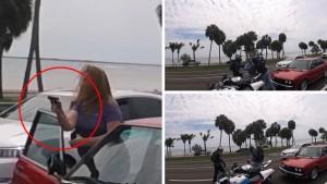 Lite nel traffico, donna tira fuori pistola5