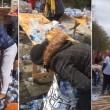 Pubblico ruba acqua minerale durante Maratona Londra