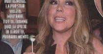 Mariah Carey, lecca lecca e scollatura esagerata FOTO