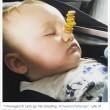 Torre di Cherrios sul neonato che dorme