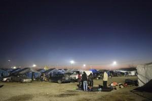 Migrante ucciso da carabiniere: rabbia del campo, rischio rivolte