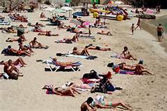 Guarda la versione ingrandita di Vacanzieri al mare