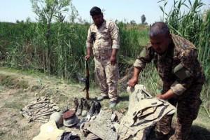 Guarda la versione ingrandita di Isis, trovate 72 fosse comuni tra Iraq e Siria: almeno 15mila morti  (Foto Ansa)