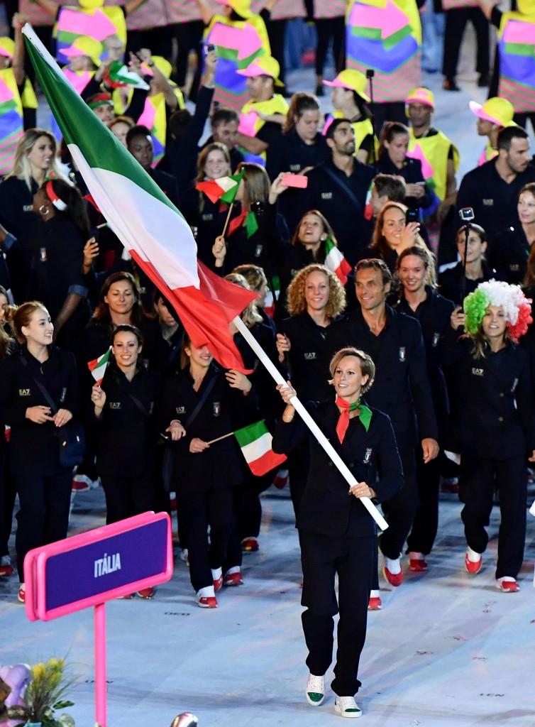 Italian swimmer Federica Pellegrini carries the Italian flag