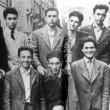 La classe di Silvio Berlusconi, terzo da sinistra in alto (foto Ansa)