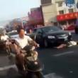 Cina, donna finge di essere stata investita3