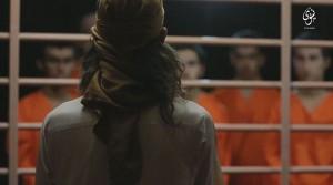 Guarda la versione ingrandita di Isis, segno nero su testa prigionieri con bomboletta spray prima di sparare FOTO-VIDEO
