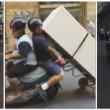 Napoli, trasportano frigorifero con lo scooter