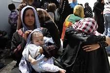Guarda la versione ingrandita di Donne a Mosul
