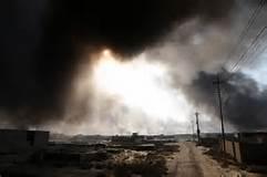 Mosul avvolta dal fumo