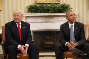 Guarda la versione ingrandita di Obama e Trump: salta la foto con Melania e Michelle (Foto Ansa)