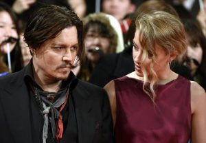 Johnny Depp e Amber Heard, divorzio chiuso: a lei cani, a lui moto e auto