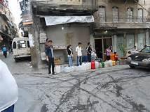 Una fila per l' acqua ad Aleppo