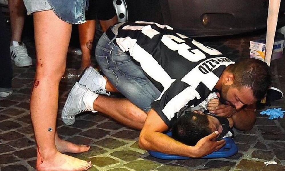 Federico Rappazzo, il ragazzo che ha abbracciato il bambino in piazza San Carlo FOTO